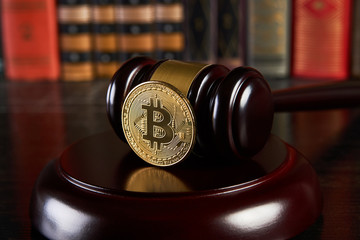 Crypto currency law, judge gavel, stacked legal book and bitcoin