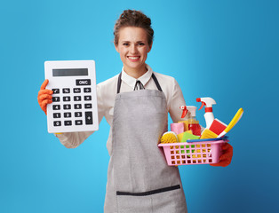 housemaid with a basket with cleansers and brushes showing big c