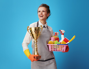 scrubwoman with a basket with cleansers, brushes and gold goblet