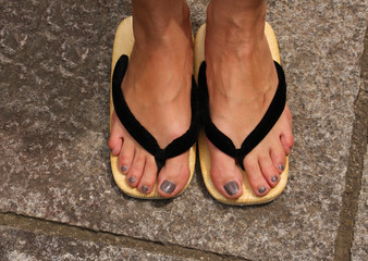 "Young woman with ""Geta"" - traditional Japanese sandals"