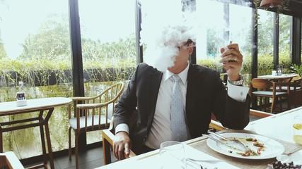 Businessman vaping electronic cigarette
