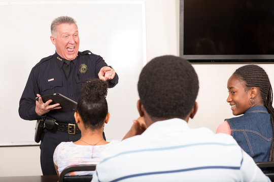 Officer teaching community outreach class full of students