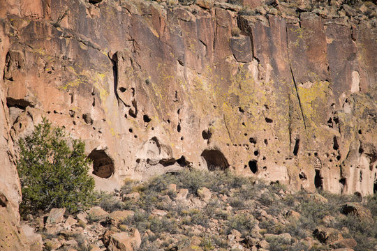 Caves and abandoned ancient ruins in a colorful cliff in Bandelier National Monument near Santa Fe, New Mexico
