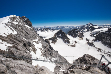 Fototapete - Titlis cliff walk with the view of Swiss Alps, Switzerland, Europe.