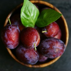Overhead view of plums in bowl