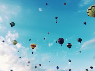 Hot air balloons flying in blue sky