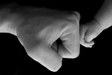 Close up of father and son fist bump