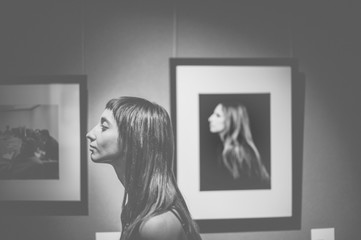 Side view of woman standing in an art gallery