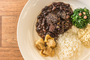 White dish with ingredients of feijoada, typical food of Brazil