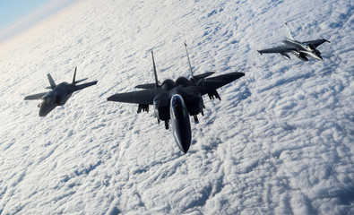 """An RAF F-35B Lightning, a USAF F-15E Strike Eagle and a French Rafale fly over The English Channel in formation during the """"Point Blank"""" exercise, after taking off from RAF Mildenhall"""