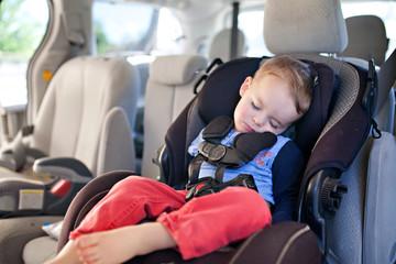 Boy sleeping in a car seat