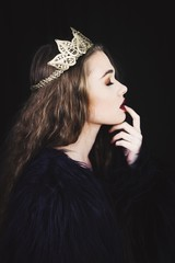 Close up of a beautiful young woman wearing a crown