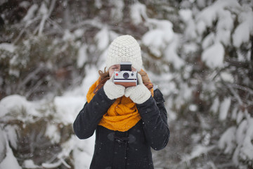 Girl taking a photograph in winter