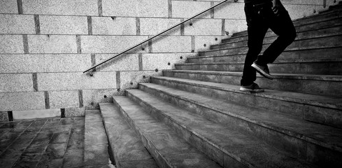 Low section of a man walking up the steps