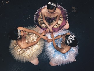 Overhead view of teenage girls ballet dancing on stage