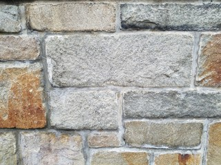 Stone wall with gray and brown variations