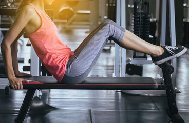 Sport woman doing situp or crunches in gym,Female exercise muscular her stomach,Close up