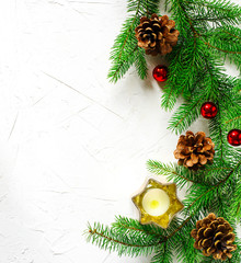 Christmas holiday background with fir branches, pine cones and ornaments