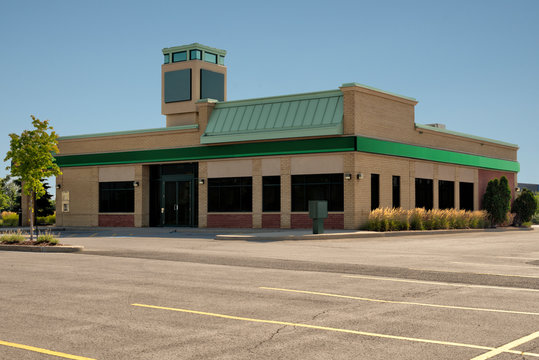 Unoccupied generic front side of store, business or professional office space. Sunny summer day.