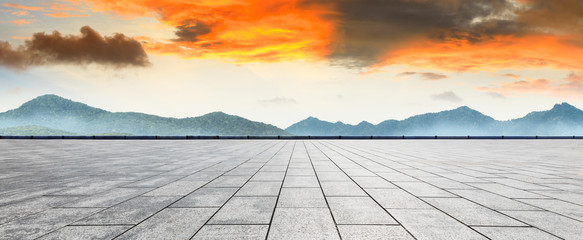 Fototapeta Empty floor and mountain with beautiful clouds at sunset
