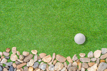 Golf ball on green with small stone on grass abstract  for background