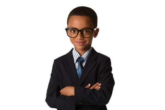 Elegant little boy with glasses in business suit. Concept of leadership and success. Isolated
