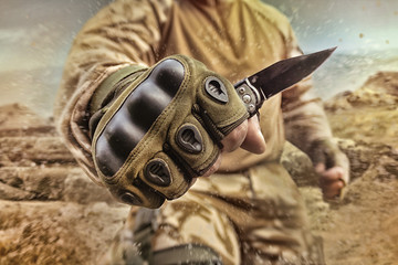 Military soldier holding a knife.