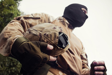 Soldier with helmet.