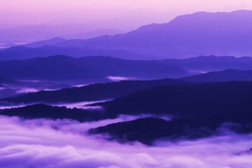 sunset overlooking mountains with Mist