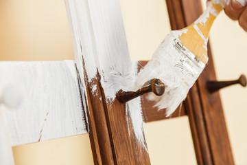 Person renovating wooden hanger