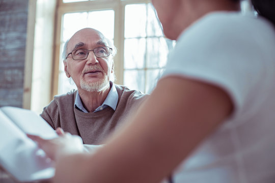 Attentive bearded man listening to his social helper