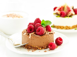 Delicious New York Chocolate Cheesecake with Raspberries. close-up.