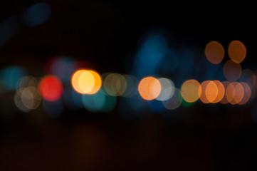 Abstract blurred street lights and garlands. Celebration concept.
