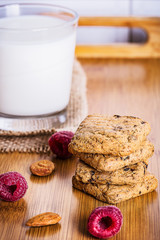Oatmeal cookies with raspbarry and milk in a glass, healthy snac