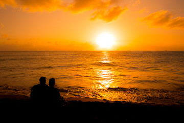 Silhouette of a couple people at sunset
