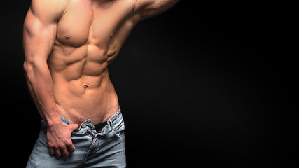 sexy male shirtless torso in jeans. Perfect abs
