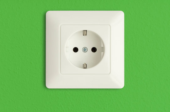 electrical outlet on green wall, green power, electric socket, european default,