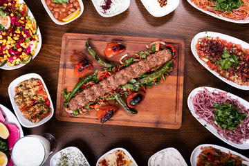 Adana Kebab Set Plate on Wooden Table with Ayran