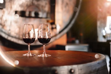 Two glasses of Porto Wine standing on the barrel in wineyard's restaurant