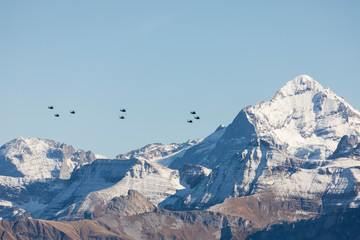 The Swiss Air Force flies with its helicopters a display in the Alps in the Bernese Oberland in Switzerland