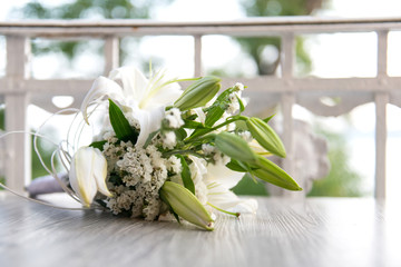bridal bouquet on a white wooden bench - selective focus, copy space