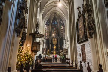 Vienna, Austria - December 31, 2017. Interior of Maria am Gestade or Church of Our Lady of the Riverbank with Christmas decoration. One of the oldest viennese churches of gothic architecture.