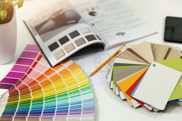 designer workplace - interior paint color and furniture material samples