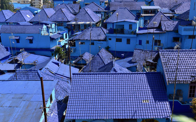 Blue rooftoops and the blue houses of the village Kampung Biru Arema, Malang City, East Java, Indonesia