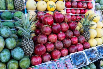 Big assortment of fresh organic fruits. Frame composition of fruits on market.