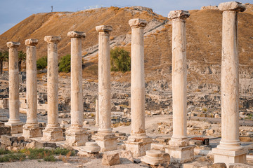 Ruins of the roman period in Beit She'An in Galilee in Israel, the hill on the background is the tell from the canaanite period