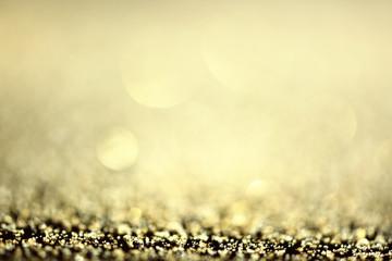 Bright golden glitters, closeup