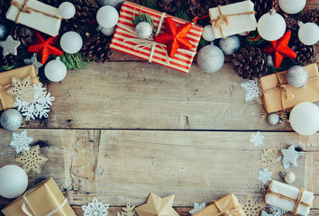 Christmas background with gift boxes and decorations on the wooden table.