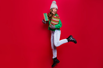 Full-lenght photo of jumping energy young lady wearing winter outfit with new year presents prepearing for winter holiday and celebration of new year