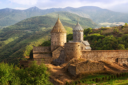 Ancient monastery in sunset. Tatev. Armenia